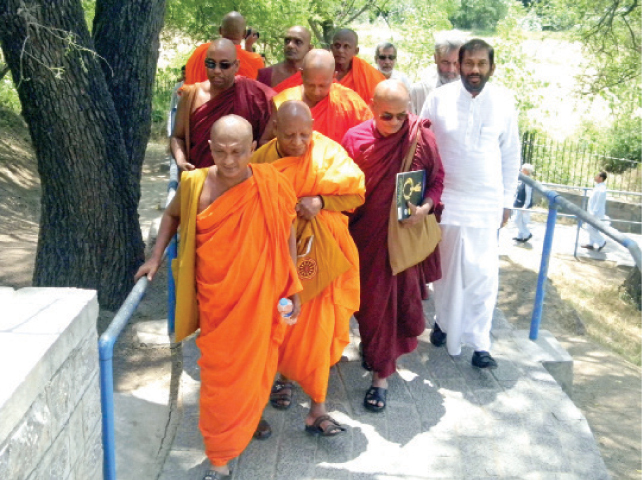 Sri Lankan monks visit Dharmarajika stupa and monastery near Taxila on Monday. — Dawn
