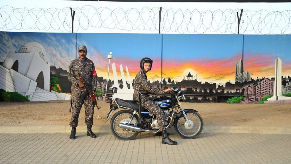 Security forces use the new mural as a photo op