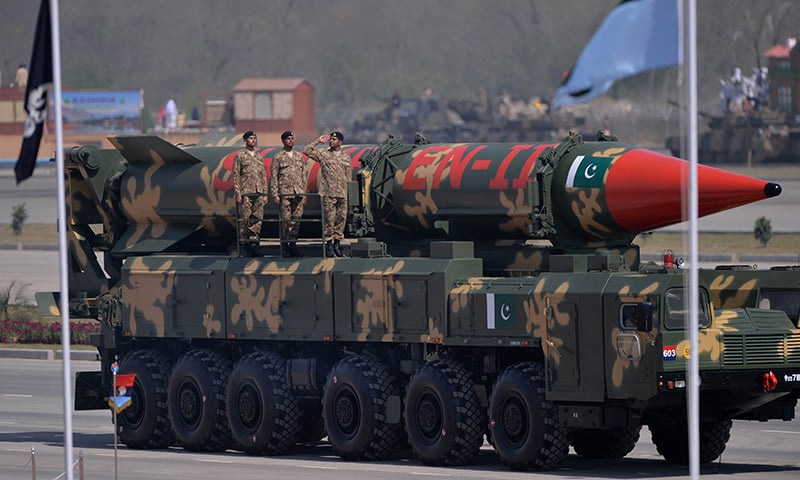Soldiers stand beside the long-range ballistic Shaheen II missile during the Republic Day parade in Islamabad | AFP