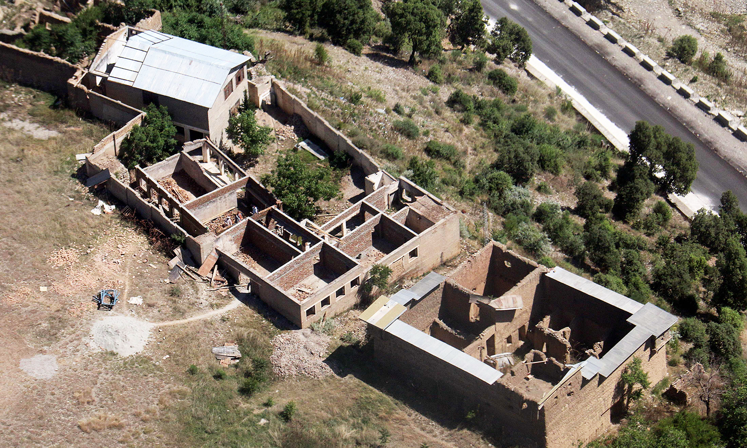 In this photograph taken from a Pakistani army helicopter on May 20, 2016, empty houses whose roofs have been removed by the army during an operation in South Waziristan.— AFP