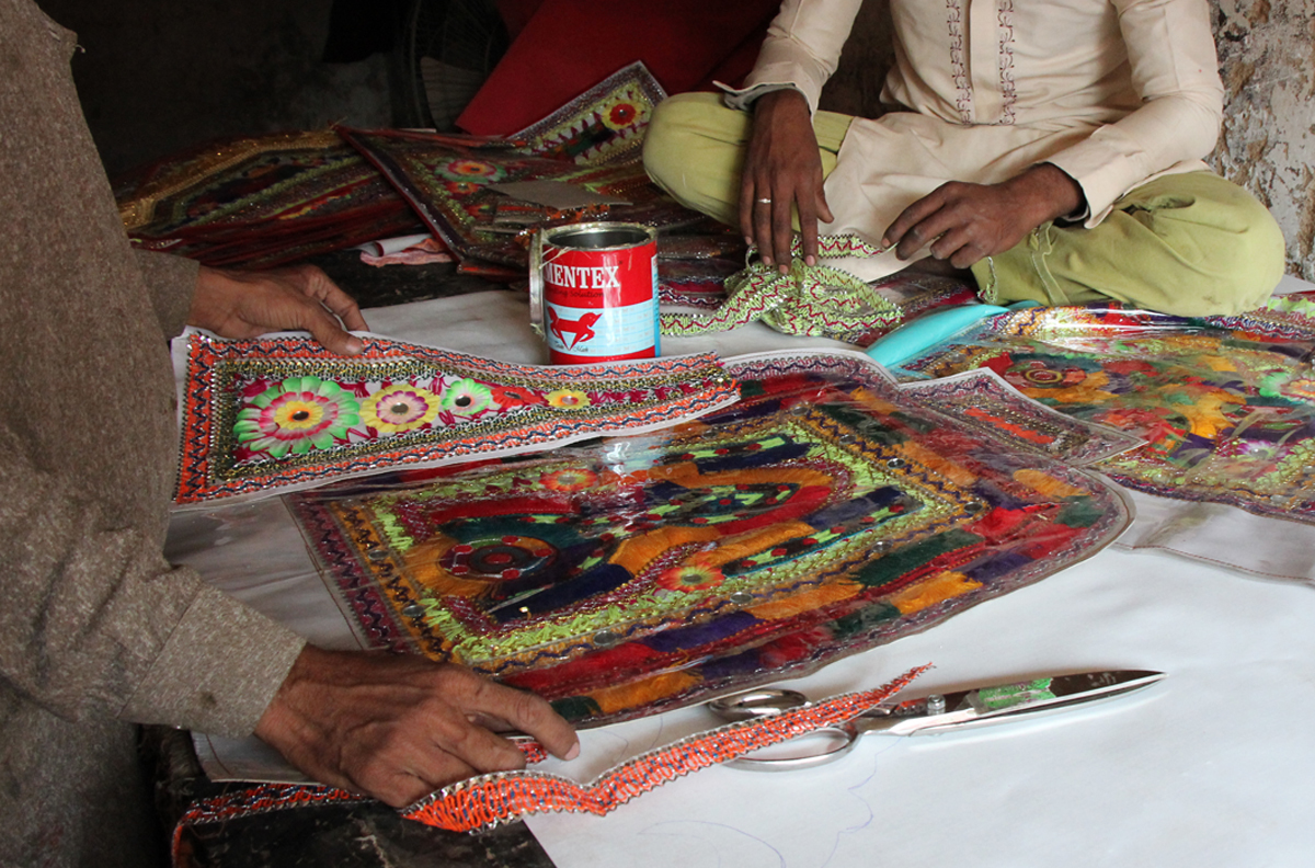 Seat covers for trucks being prepared in Hala, Sindh