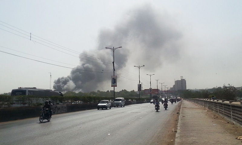 A cloud of smoke rises from the PIA facility at the Karachi airport on Saturday. – Photo: Waqar Muhammad Khan