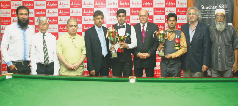 BABAR Masih (fourth L) and Asjad Iqbal pose for a photograph with PBSF officials after receiving the trophies on Saturday.