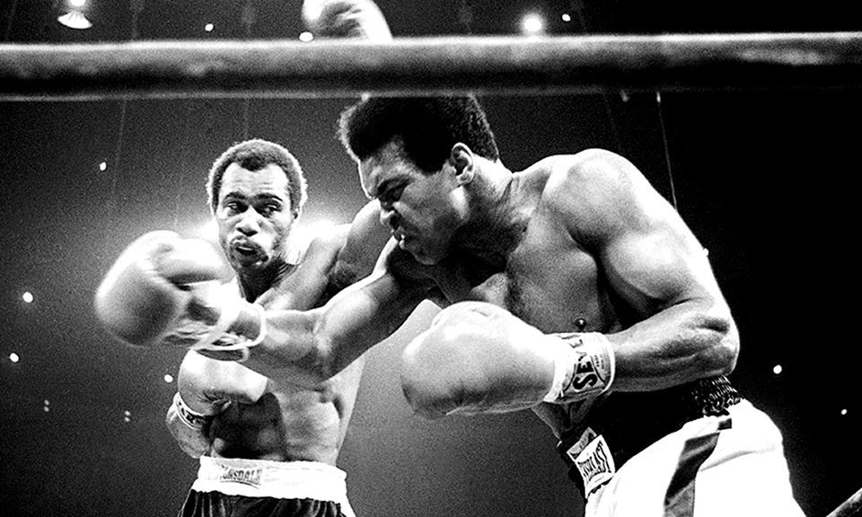 In this Sept. 10, 1973, file photo, Muhammad Ali, right, winces as Ken Norton hits him with a left to the head during their re-match at the Forum in Inglewood, California. Photo: —AP