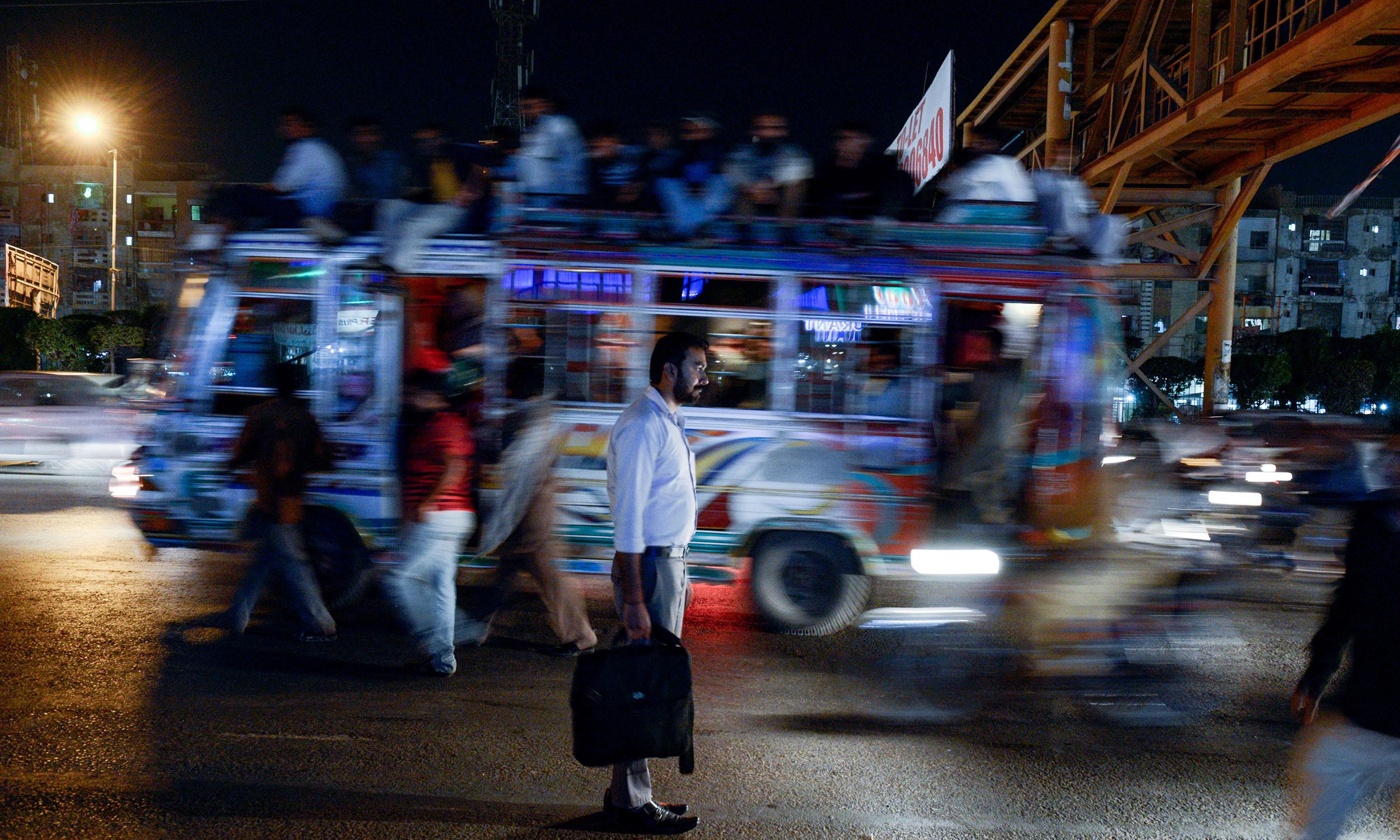 A man during his commute in Karachi | Tahir Jamal, White Star