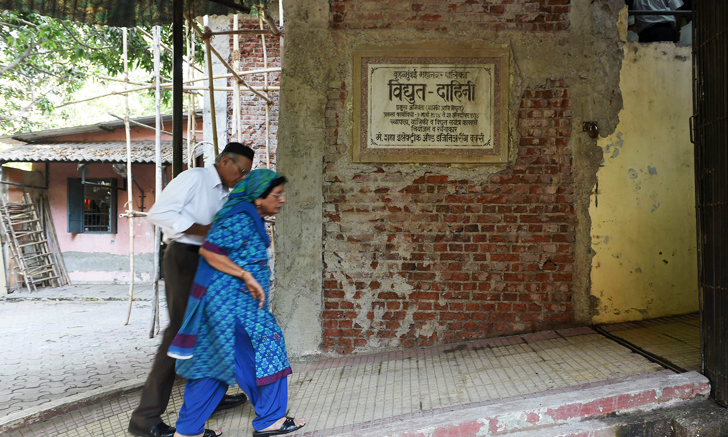 In this photo taken on May 10, 2016, a Parsi couple enters an electric crematorium to attend the last rites of a member of the community at a prayer hall in Mumbai.