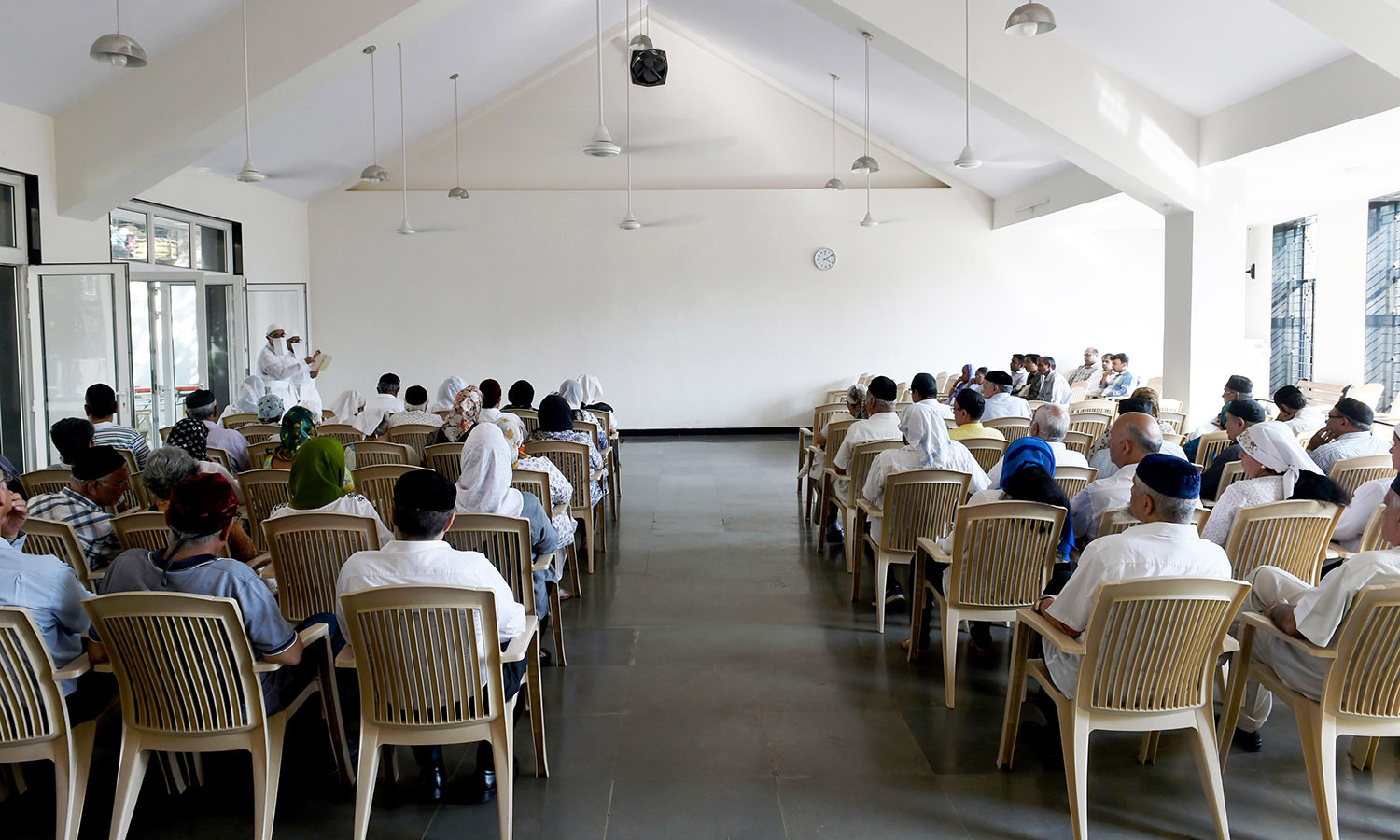 In this photo taken on May 10, 2016, Parsi priests conduct a funeral service at a prayer hall in Mumbai.