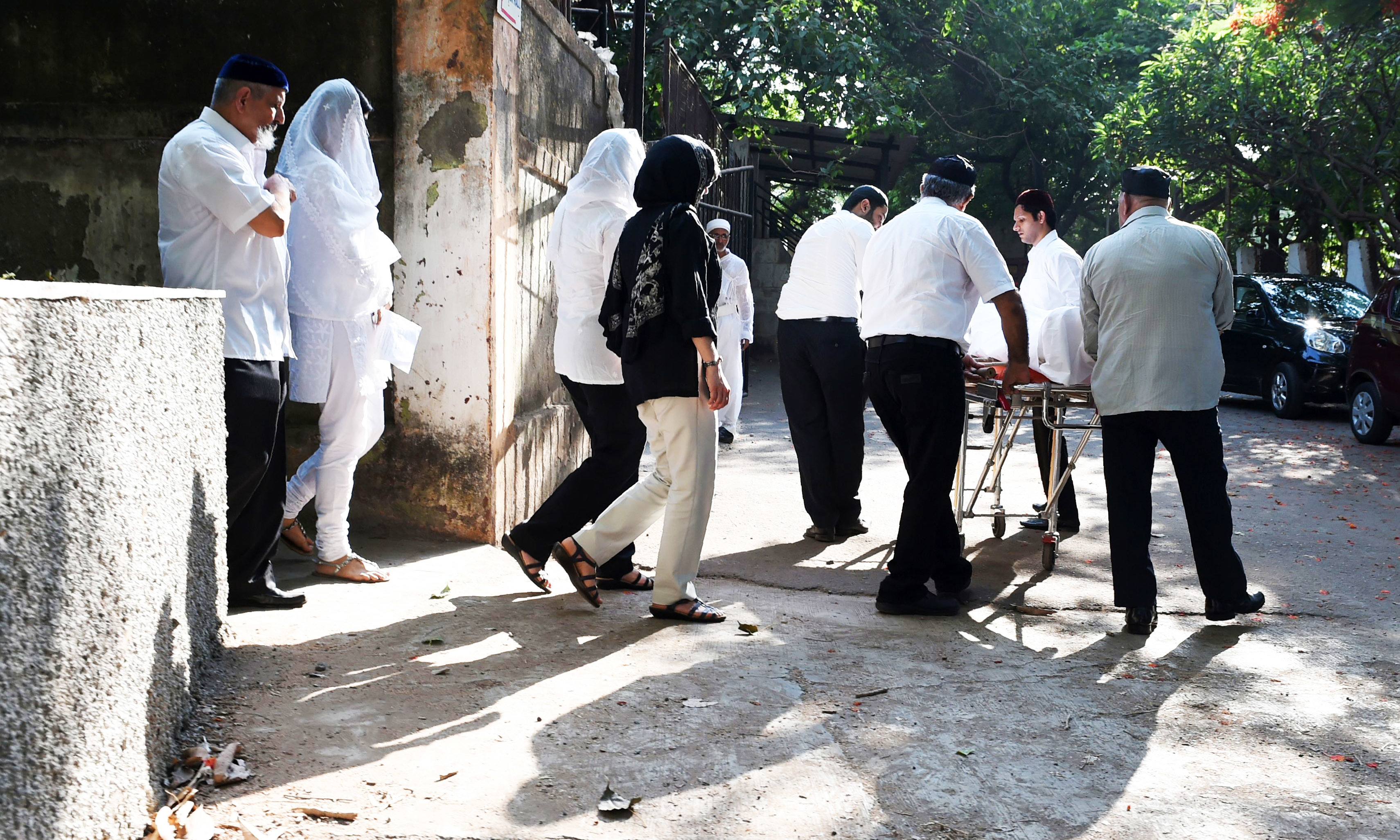 In this photo taken on May 10, 2016, friends and family members take part in a funeral procession of a member of the Parsi community at a prayer hall in Mumbai.