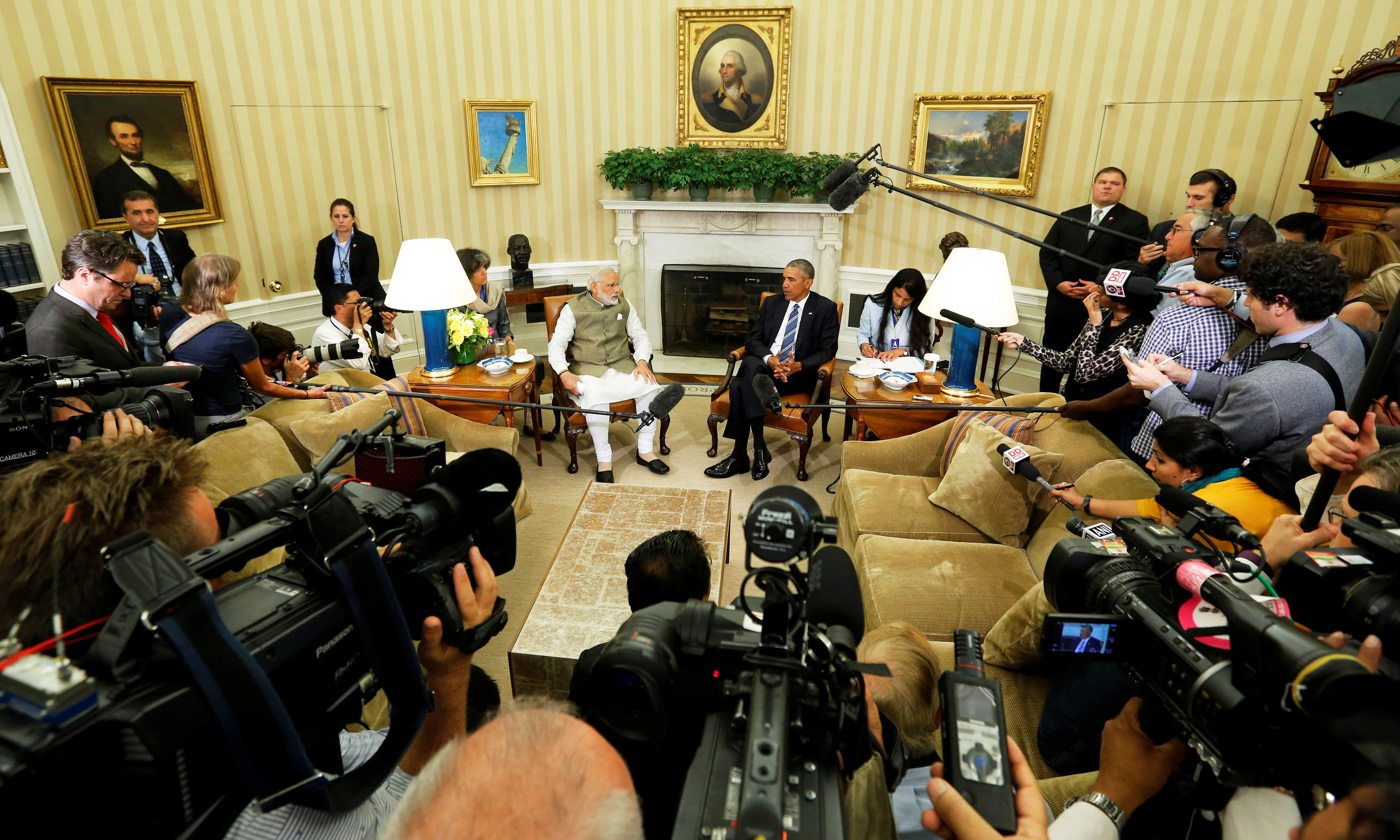 Narendra Modi and Barack Obama make remarks to reporters after their meeting in the Oval Office at the White House in Washington. —Reuters