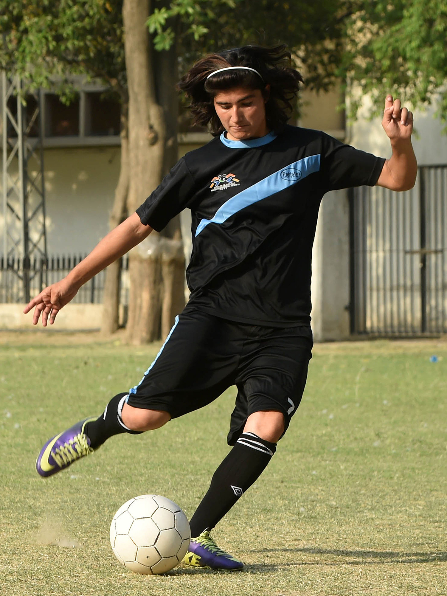 Diana Baig takes part in a football training session at a ground in Lahore. — AFP