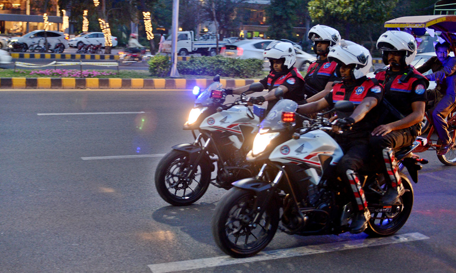 Dolphin street crime control force patrolling on their first day on the job. —Photo by Azhar Jafri/White Star