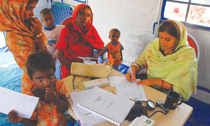 Access to health care is not universal in the country: a doctor treats her patients; medical staff perform a slit-lamp examination checkup on the eyes of patient