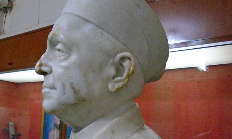 Das' statue shows signs of damage around his nose and ears. —Photo by Sarmad Soomro