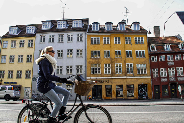 A woman rides a bicycle in Christianshavn District Of Copenhagen. Since 2012, Denmark has been a place where you can get paid to borrow money and charged to save it.—File photo/Bloomberg