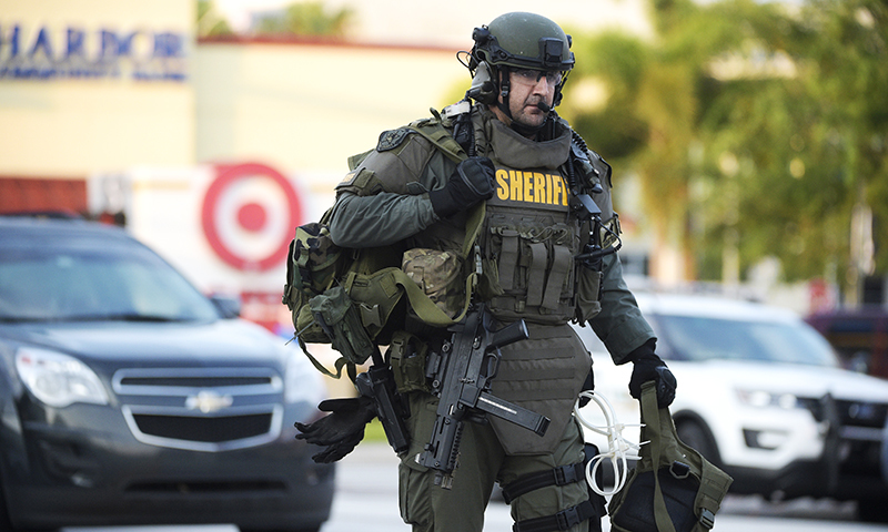 An Orange County Sheriff's Department SWAT member arrives to the scene of a fatal shooting at Pulse Orlando nightclub in Orlando. -AP