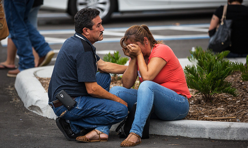 Friends and family grieve after a list of hospitalised victims was released, implying the death of those who weren't on the list and hadn't been heard from in Orlando, Fla., Sunday, June 12, 2016. —AP