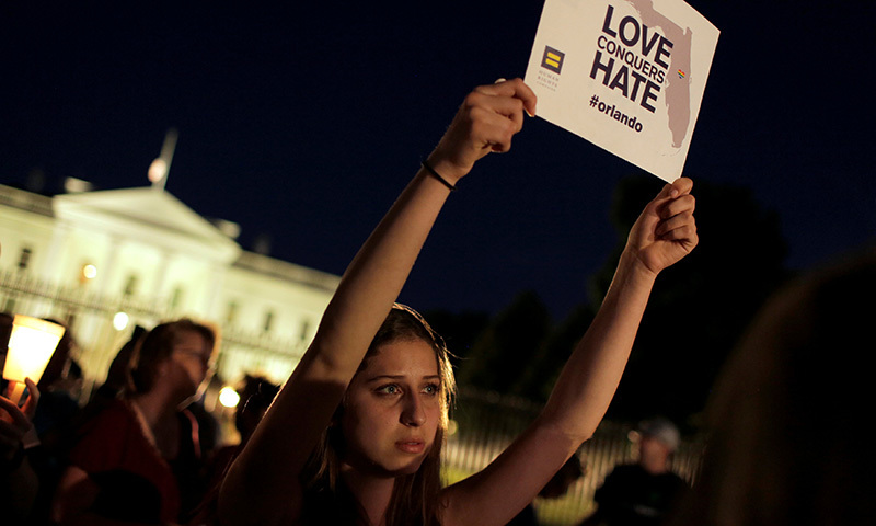 A woman holds up a placard during a vigil in front of the White House in Washington, US, June 12, 2016. —Reuters