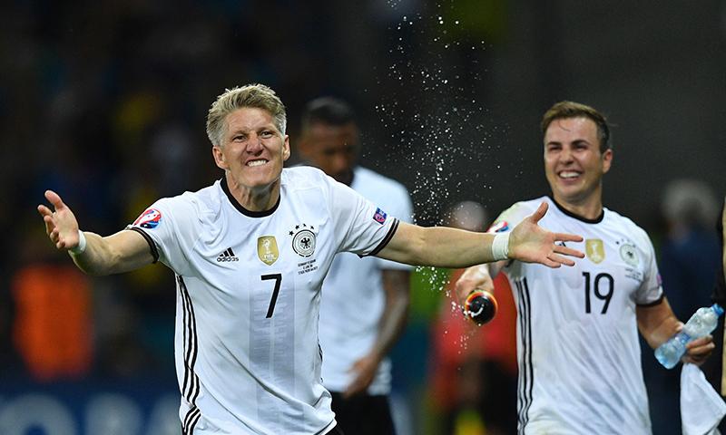 Germany's midfielder Bastian Schweinsteiger (L) celebrates with teammates after scoring a goal. — AFP