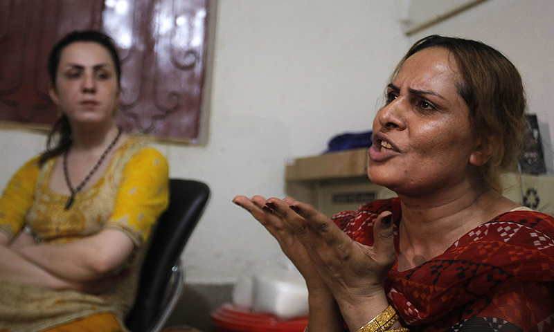 In this Tuesday, May 31, 2016 photo, Pakistani transgender guru Farzana, right, tells what happened to Alisha who was killed in Peshawar. — AP