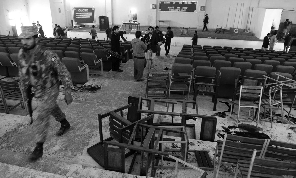Journalists gather in the auditorium of the Army Public School in Peshawar after the massacre on 16 December, 2014 | Abdul Majeed Goraya, White Star