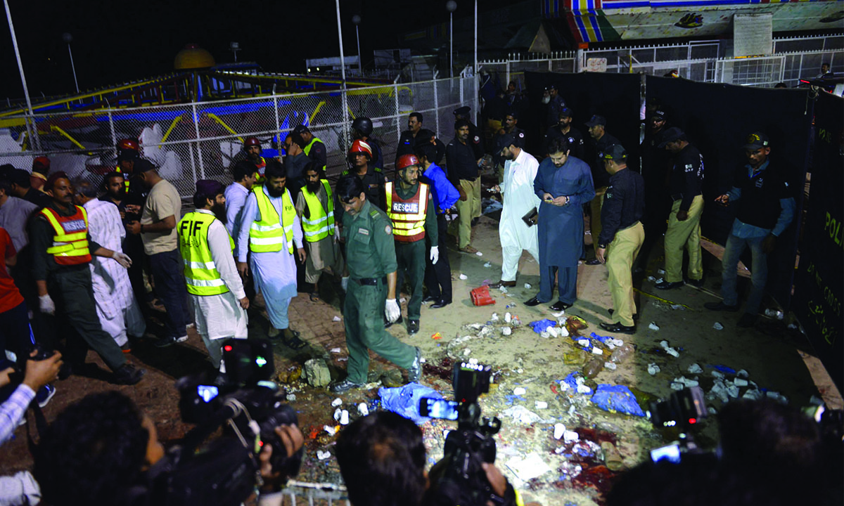 Rescue workers, officials and journalists gather at a bomb blast site in Lahore on March 27, 2016 | M Arif, White Star