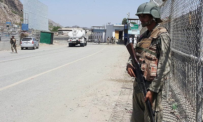 Pakistani soldiers patrol at the Torkham crossing between Pakistan and Afghanistan. -AFP