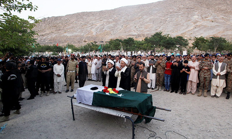 People attend the funeral for Major Jawad Changezi who was killed during cross border fighting between Afghan border forces and Pakistani forces in Torkham. -Reuters