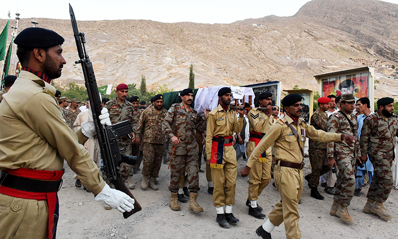 Soldiers carry the coffin of Major Ali Jawad who was killed in an overnight border exchange of fire with Afghan troops. -AFP