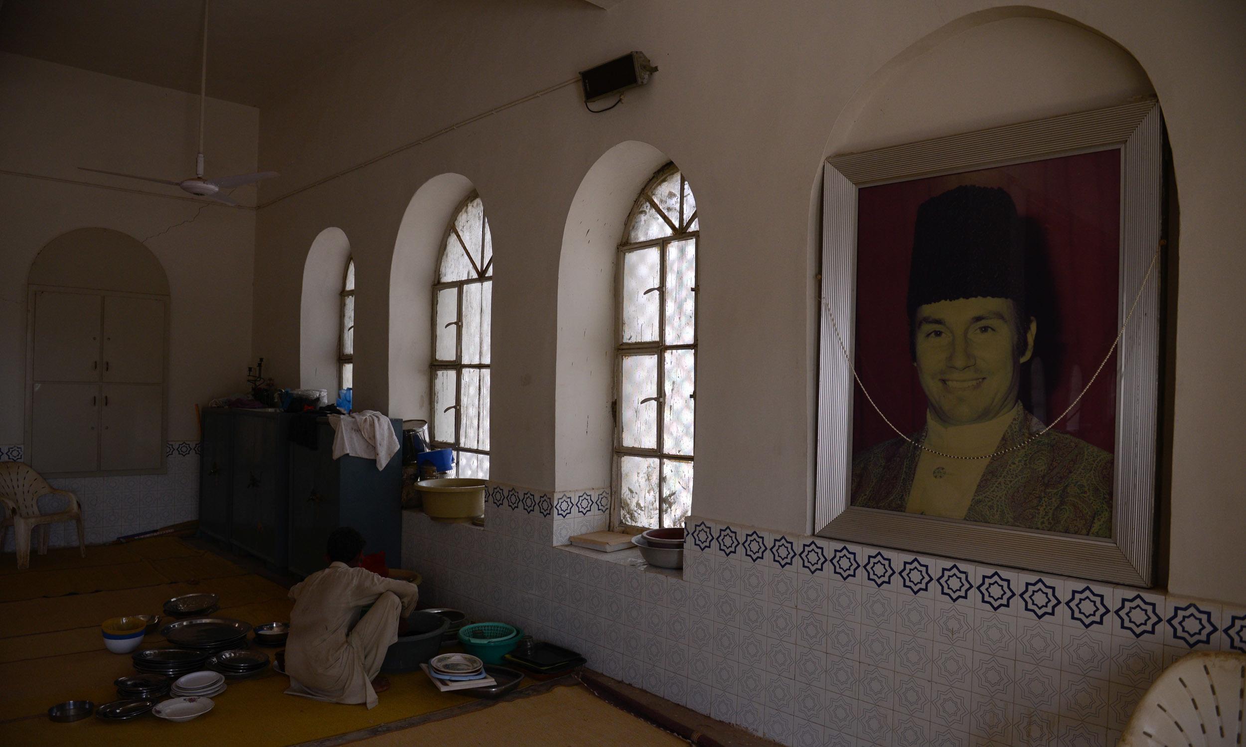 A man prepares for the gathering at the Ismaili jamaat khana in Jhimpir   Tahir Jamal, White Star