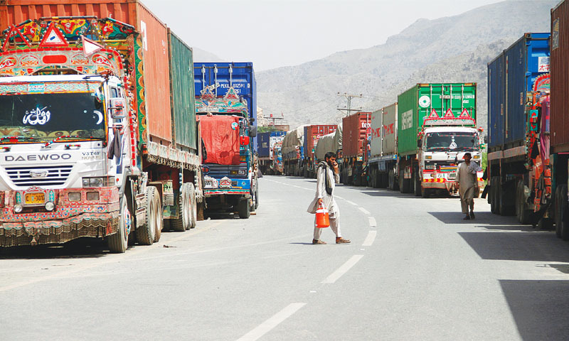 Transit trucks stranded due to the border skirmishes between Pakistan and Afghanistan are parked on the side of the road leading to the Torkham border.—Reuters