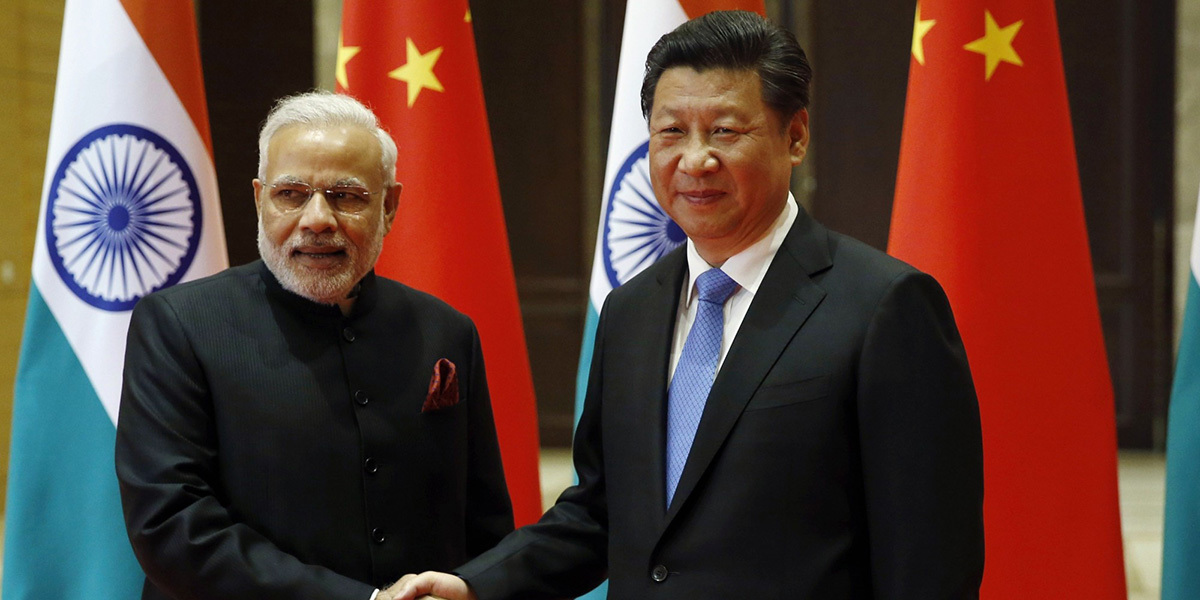 India's Prime Minister Narendra Modi and China's President Xi before a meeting in Xian, in China's Shaanxi province, on May 14, 2015 | AFP