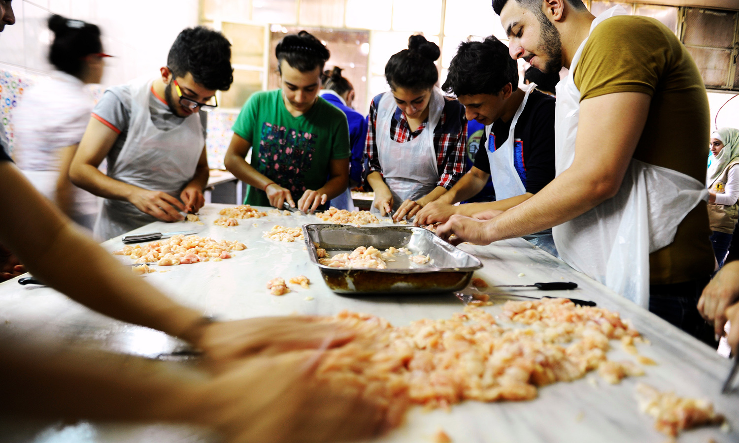 Youth, who are members of Saaed group, prepare food to be given out as Iftar meals for the poor and internally displaced Syrians during the month of Ramazan in Damascus. ─ Reuters