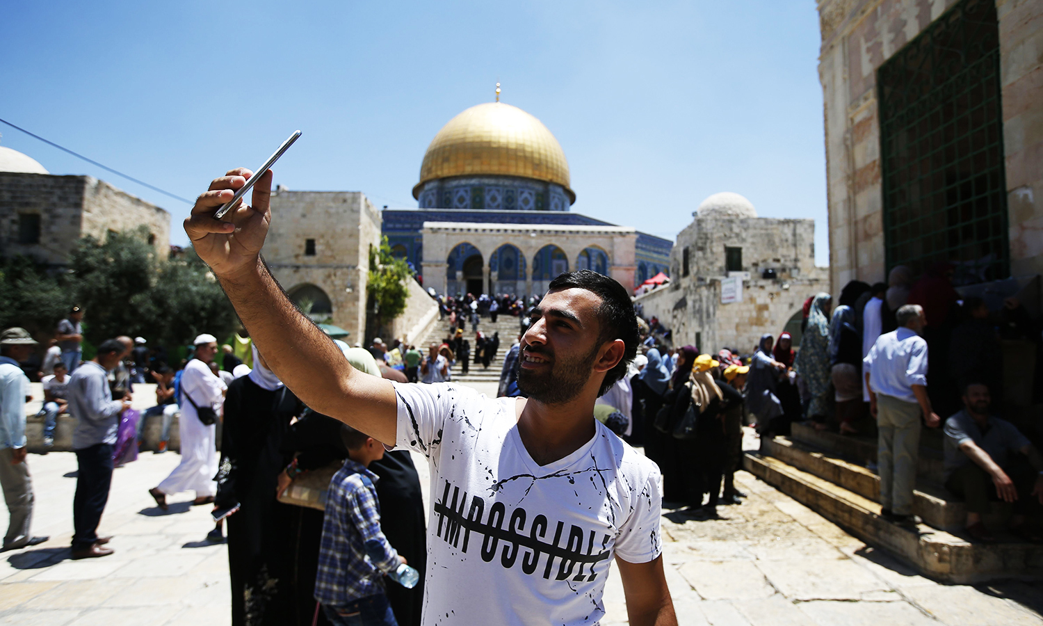 A Palestinian Muslim worshipper takes a selfie near the Dome of the Rock mosque at the Al Aqsa mosque compound in Jerusalem's old city on June 17, 2016 during Friday prayers. ─ AFP