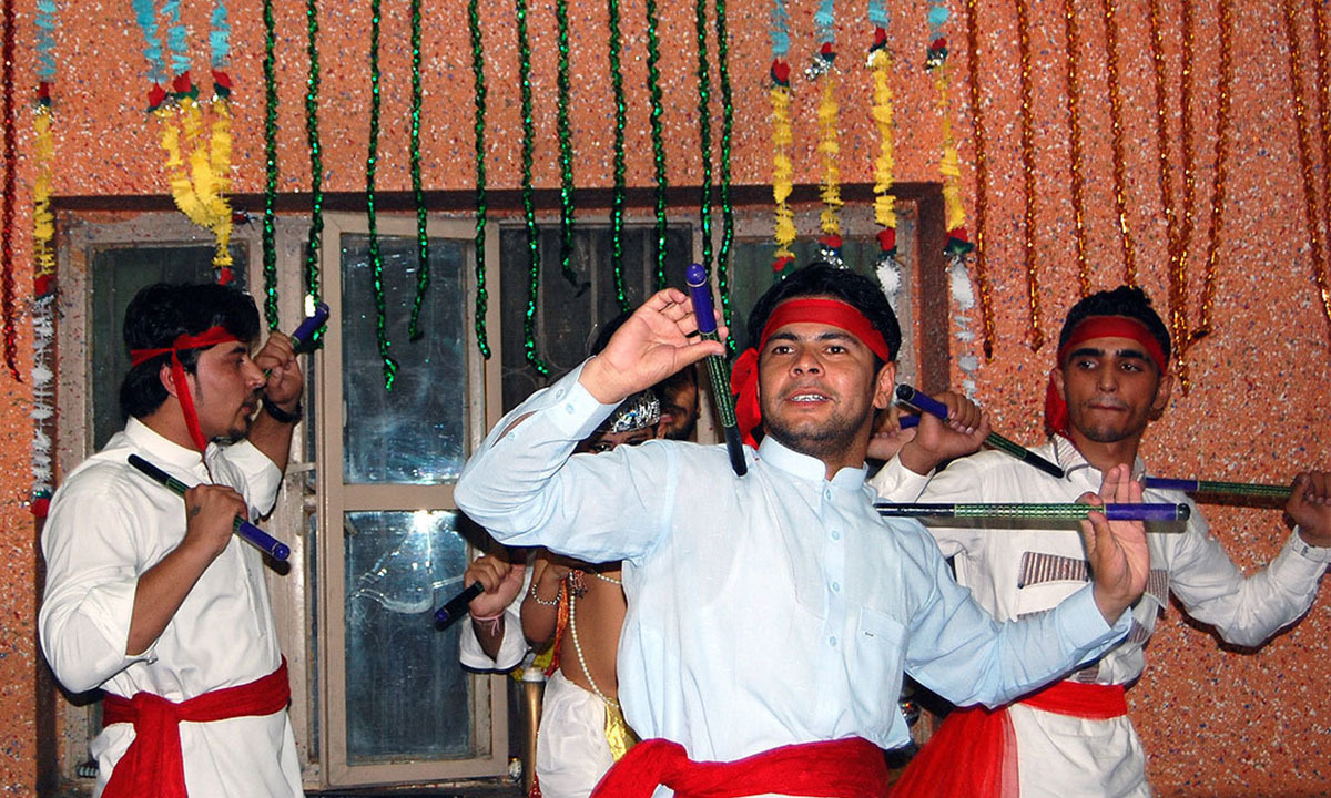 A group of boys perform on the eve of the festival of 'Janmashtami' in Chaman
