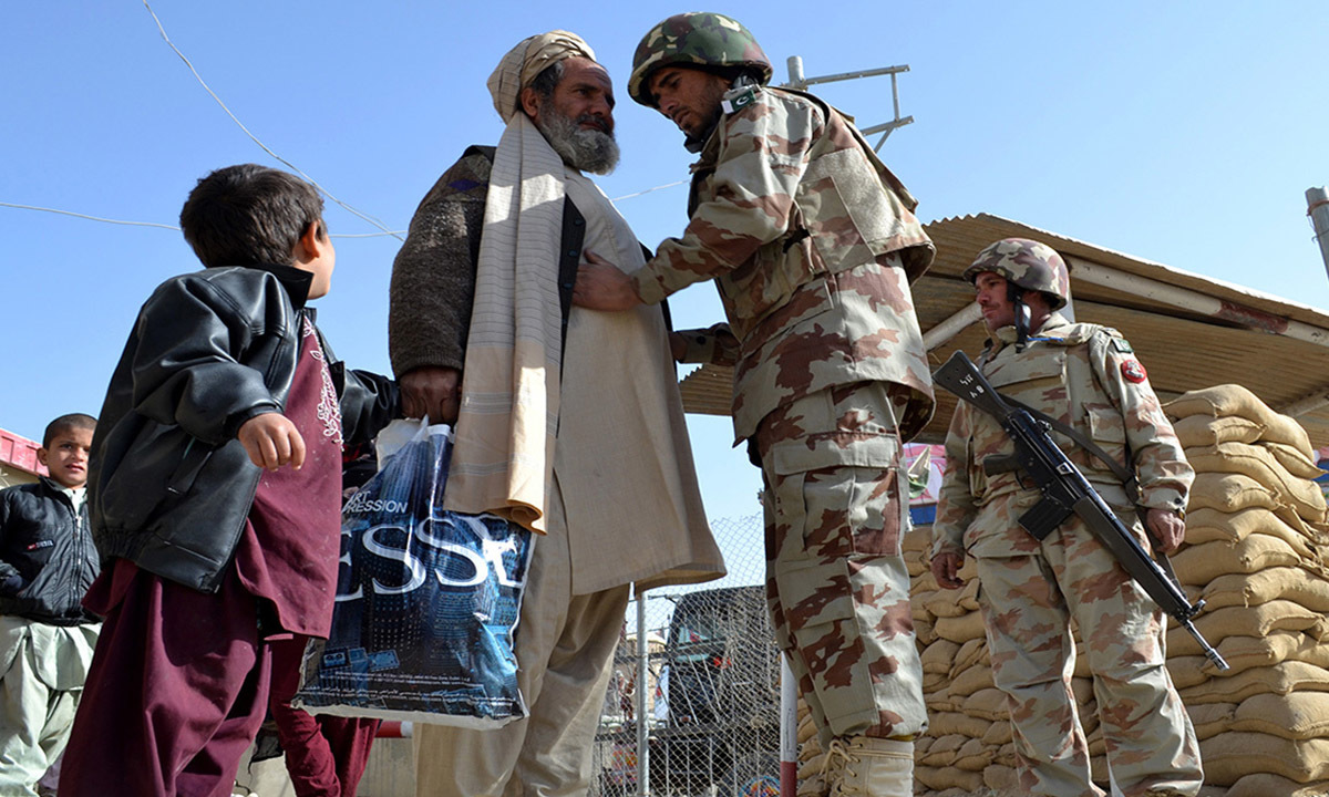 An elderly man coming from Afghanistan goes through a routine border security check