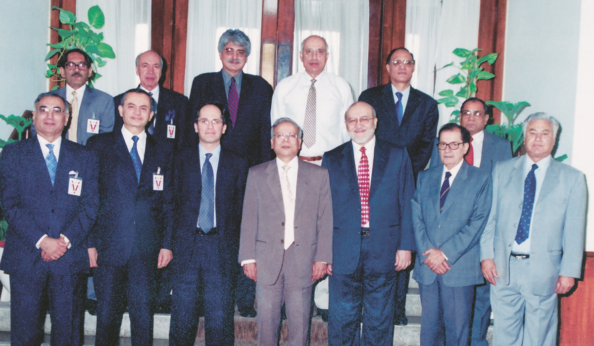 Dr Ishrat Husain (center) at a conference for economists | Courtesy Dr Ishrat Husain