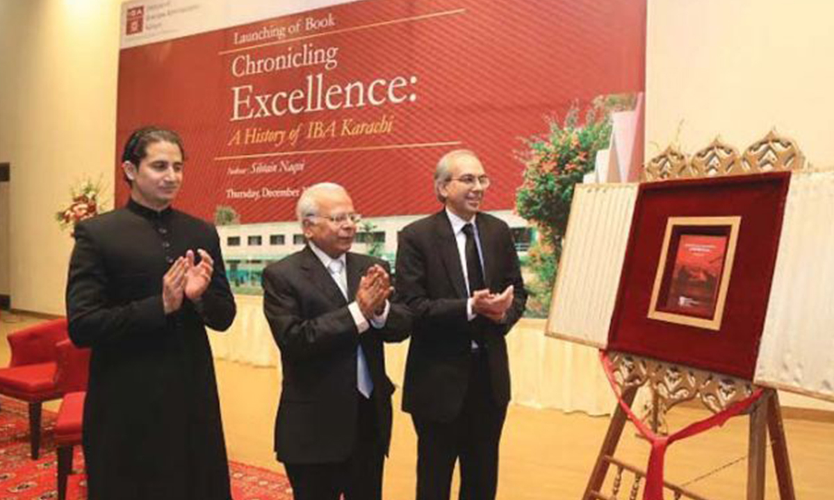 Dr Ishrat Husain (middle) unveils the book ''Chronicling Excellence: A history of IBA Karachi' along with chief guest Justice Munib Akhtar |Courtesy press release