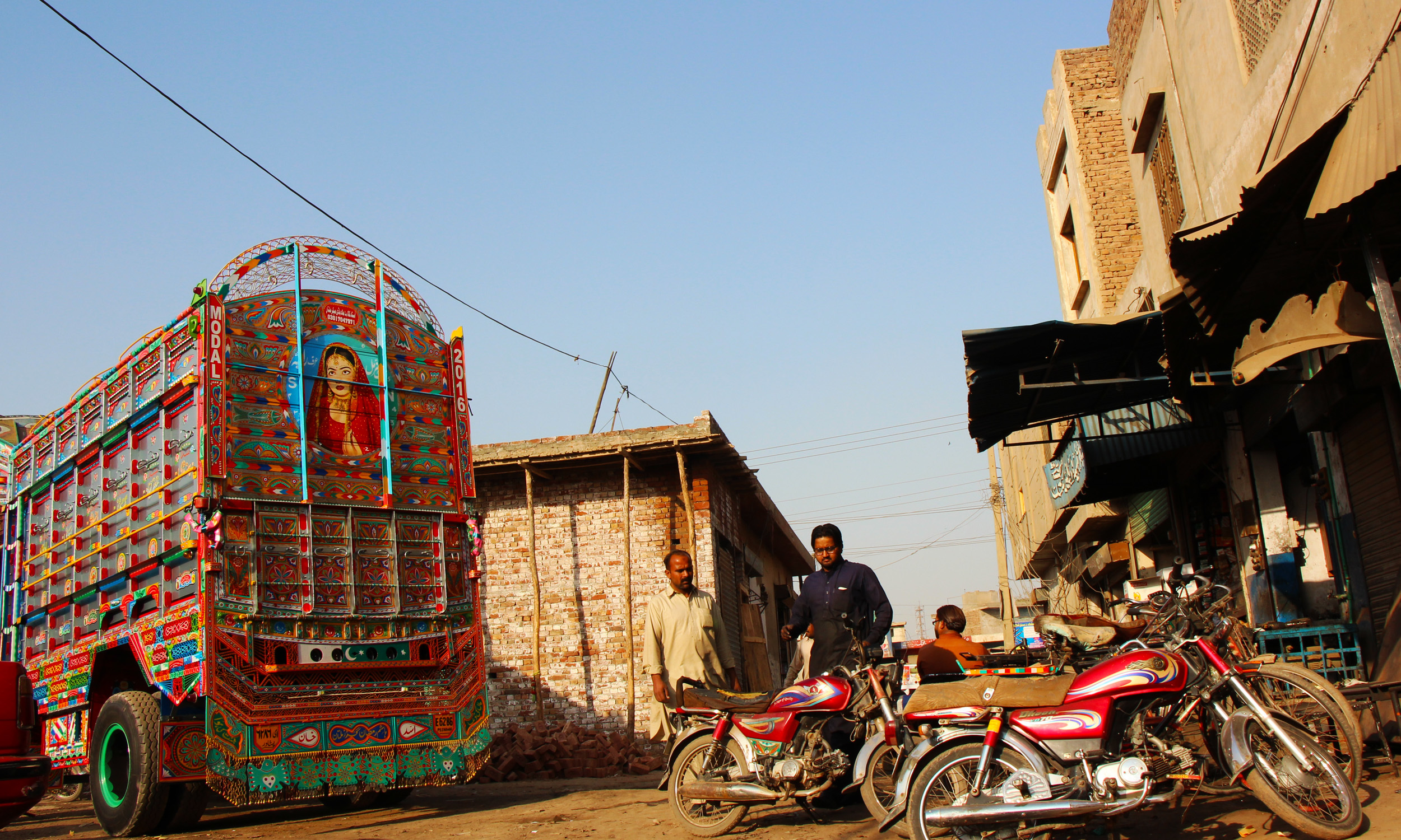 A freshly painted truck at a stand in Multan