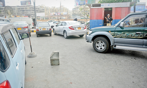 Police have placed a large stone at the car park of the supermarket in Clifton where Advocate Awais Ali Shah parked his car before being taken away by masked men on Monday.—Photo by Fahim Siddiqi/ White Star