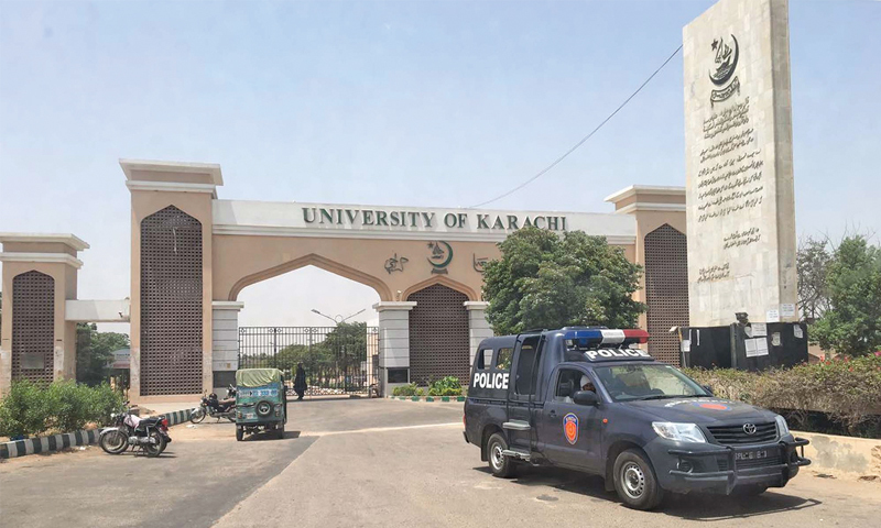 A police mobile van is parked in front of the Karachi University gate during the raid by a team of the National Accountability Bureau on the campus on Thursday.—PPI