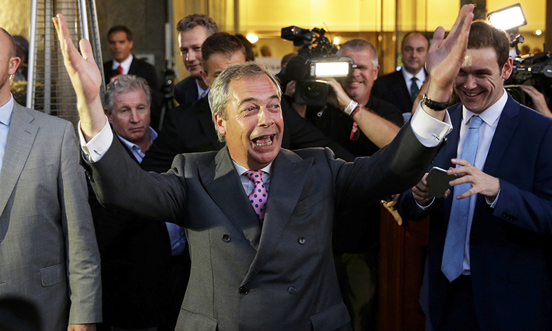 "Nigel Farage celebrates as he leaves a ""Leave.EU"" organisation party.— AP"