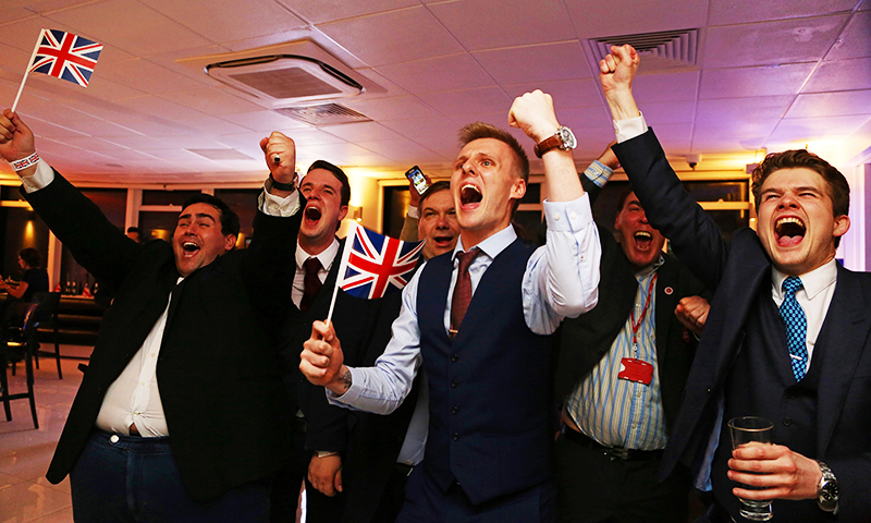 Leave.EU supporters wave Union flags and cheer as the results come in.— AFP