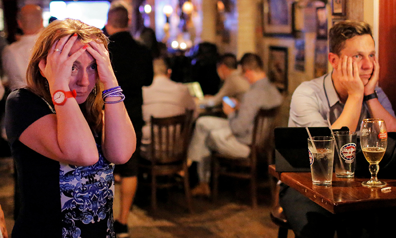 People gathered in The Churchill Tavern, a British themed bar, react as the BBC predicts Briatin will leave the EU in New York, US, June 23, 2016. — Reuters