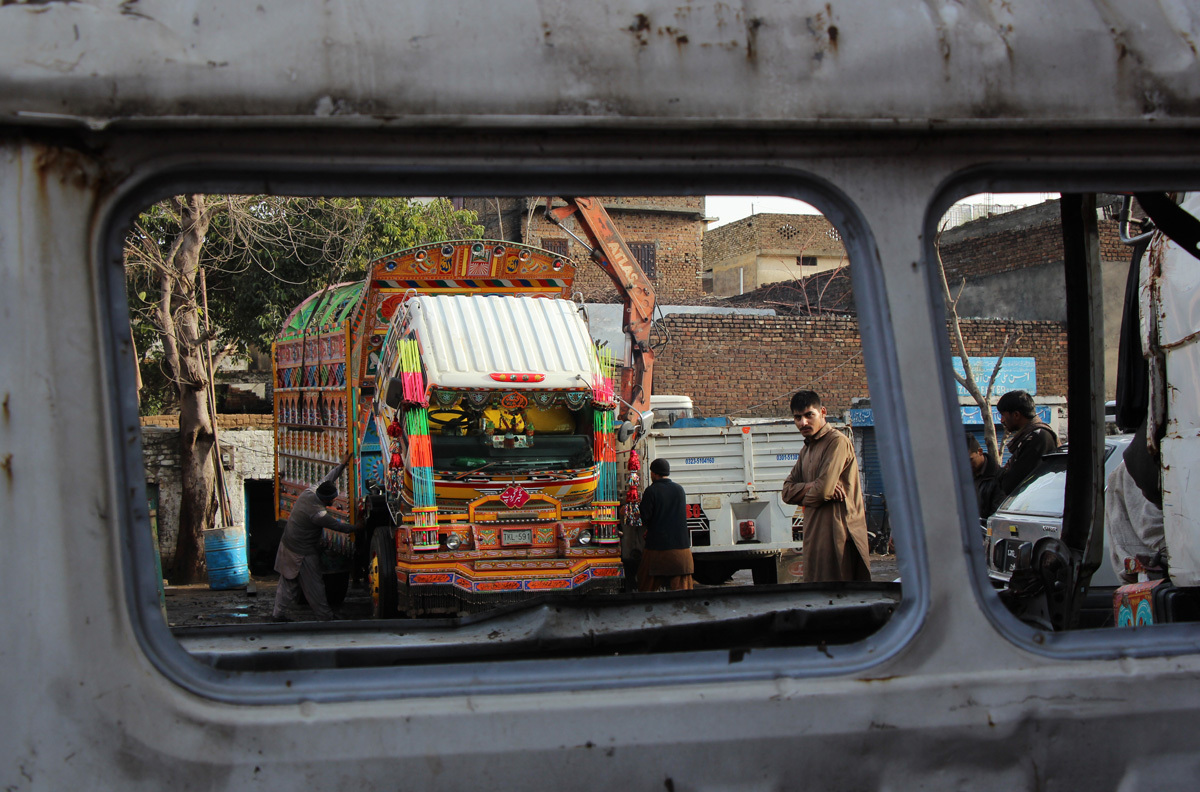 The decorated body gets placed on the truck, Rawalpindi