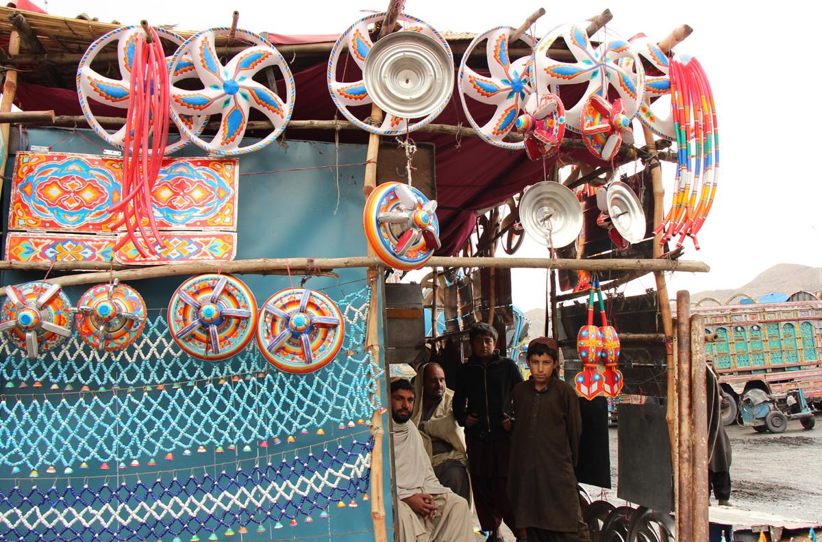 A shop sells truck decoration items at the Hazar Ganji adda, Quetta