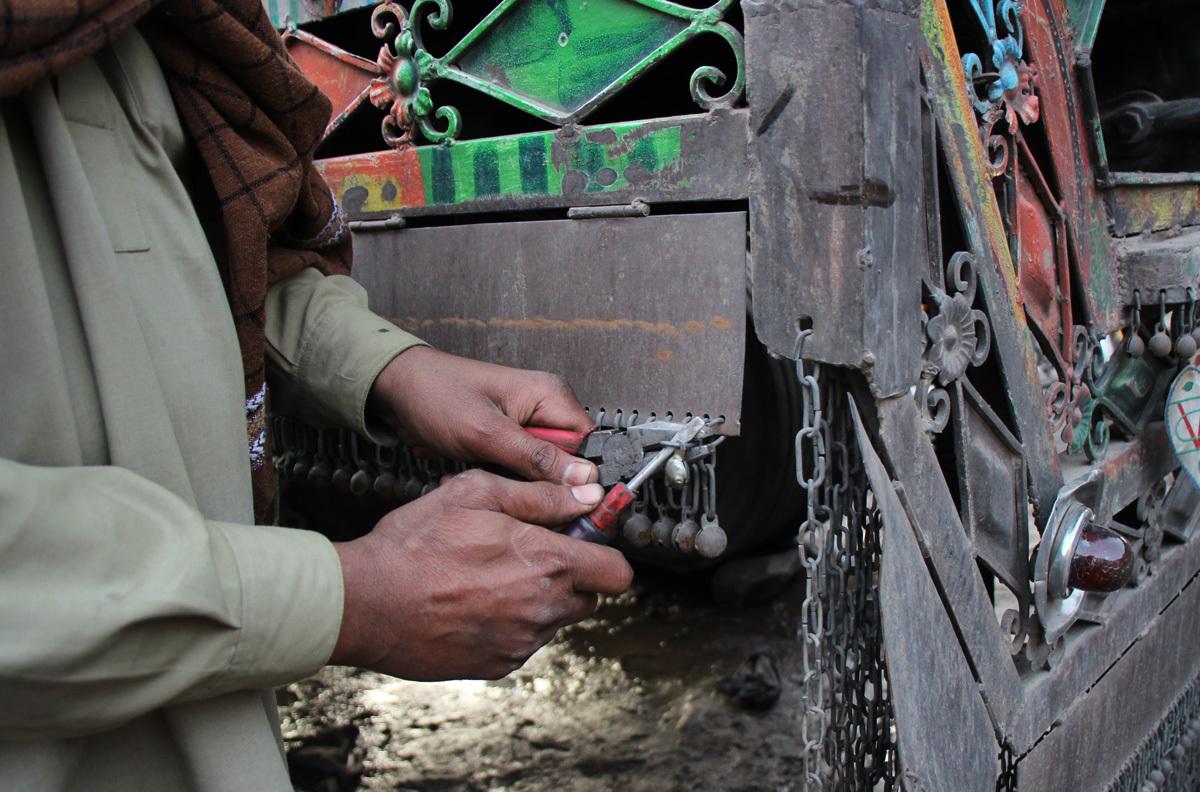 Metal balls, ghungroos, being placed on vertical steel plates in Rawalpindi