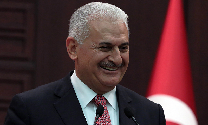 Turkey's Prime Minister Binali Yildirim smiles as he announces the details of an agreement reached with Israel, in Ankara, Turkey.─AP