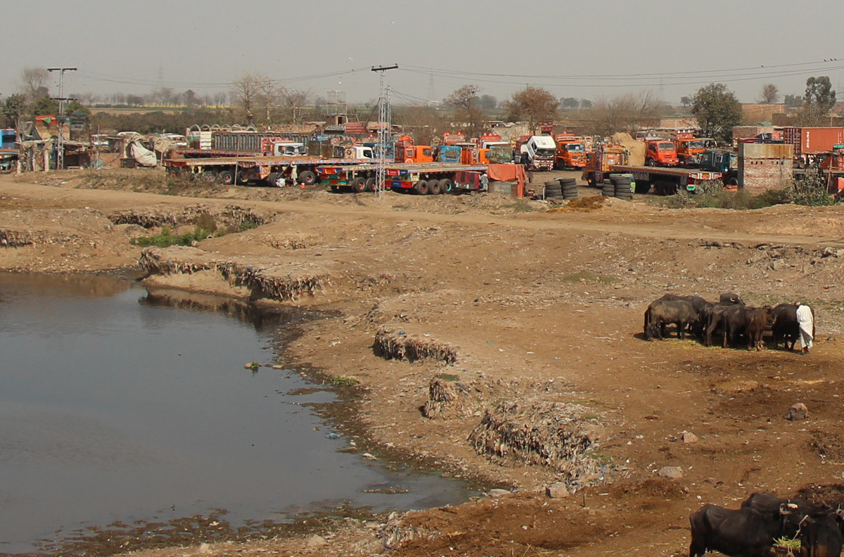 The Ravi river bed being used to park trucks, Lahore