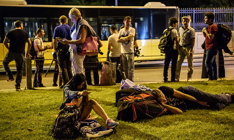 Passengers wait at the Ataturk airport's main entrance in Istanbul, on June 28, 2016.— AFP