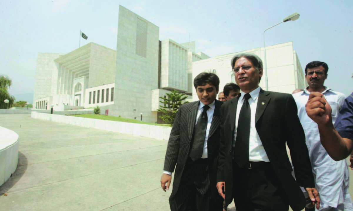 Pakistan Peoples Party Senator and lawyer Aitzaz Ahsan walking outside the Supreme Court | White Star